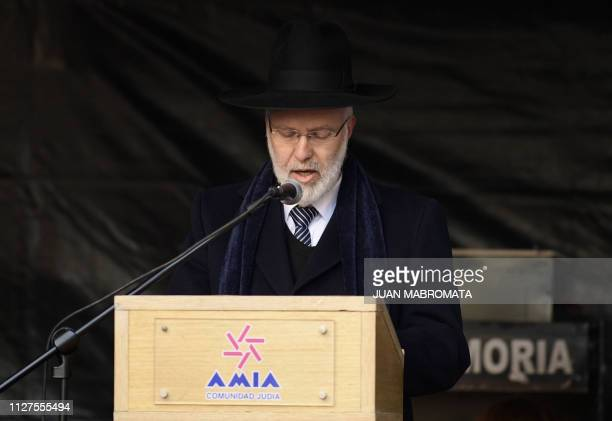 This photo taken on on July 18 2017 shows Argentina's Chief Rabbi Gabriel Davidovich delivering a speech during the commemoration of the 23rd...