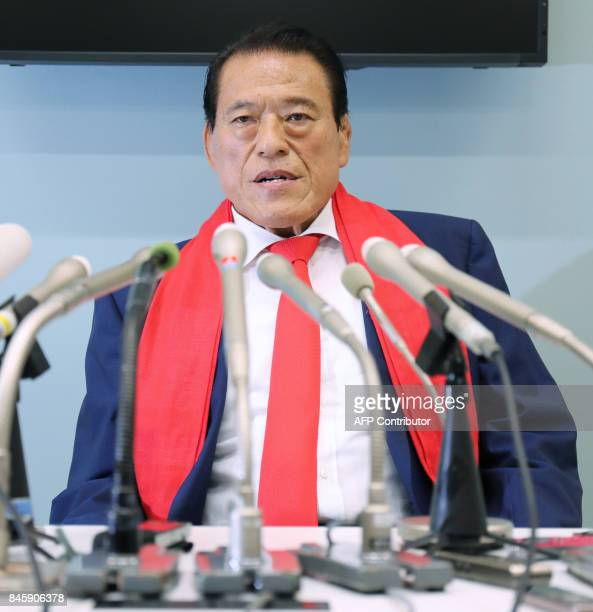 This photo taken on September 11 2017 shows Japanese wrestlerturnedpolitician Kanji 'Antonio' Inoki holding a press conference upon his arrival at...