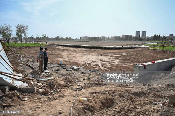 This photo taken on September 13, 2019 shows the works of a park in a place where before there was a Uighur cemetery in Kuche in the region of...