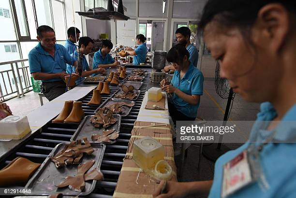 This photo taken on September 14 2016 shows workers on a production line at the Huajian shoe factory where about 100000 pairs of Ivanka Trumpbranded...
