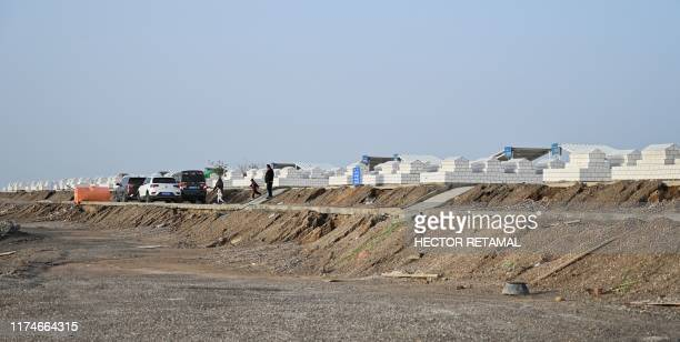 This photo taken on September 14, 2019 shows a new cemetery built on the outskirts of Aksu, Xinjiang where bodies from a destroyed Uighur graveyard...