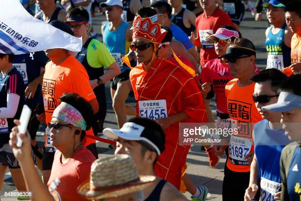 This photo taken on September 17 2017 shows a runner taking part in the 2017 Beijing Marathon dressed as Xuanzang a character from the novel Journey...