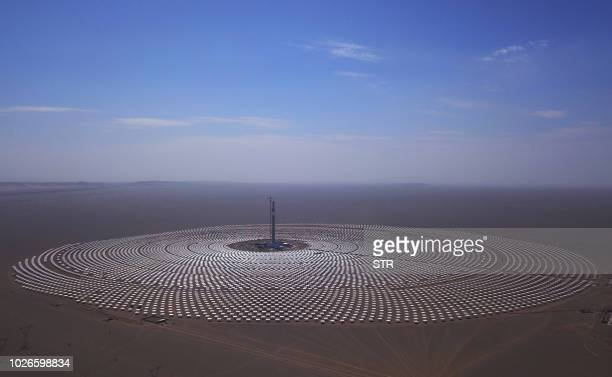 TOPSHOT This photo taken on September 2 2018 shows a view of the 100megawatt moltensalt solar thermal power plant in Dunhuang in China's northwestern...