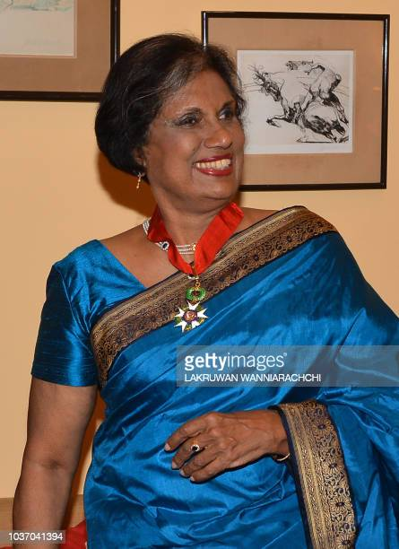 This photo taken on September 20 2018 shows former Sri Lankan president Chandrika Kumaratunga after being awarded the Commander of the Legion of...