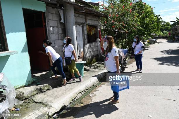 This photo taken on September 21, 2020 shows municipal health workers conducting a house to house polio vaccine campaign at a relocation site for...