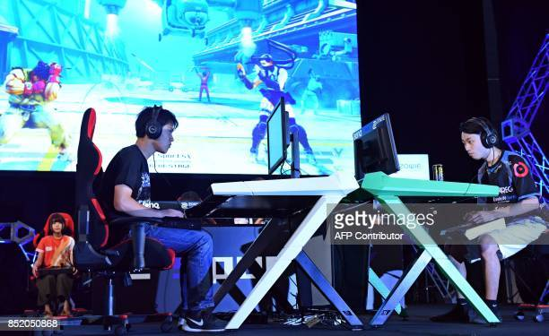 This photo taken on September 21 shows star game players compete at an eSports game event at the Tokyo Game Show in Chiba City in suburban Tokyo The...