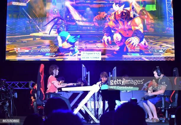 This photo taken on September 21 shows star game players fight at an eSports game event at the Tokyo Game Show in Chiba City in suburban Tokyo The...