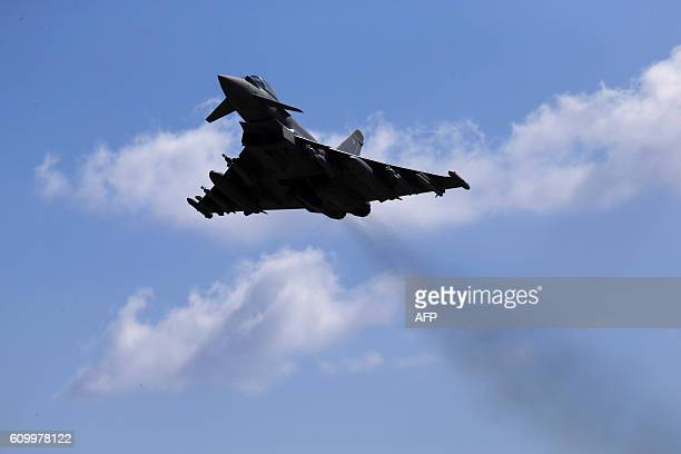 This photo taken on September 22 2016 shows a Britain's Royal Air Force Eurofighter Typhoon fighter jet taking off from RAF's Akrotiri base in Cyprus...