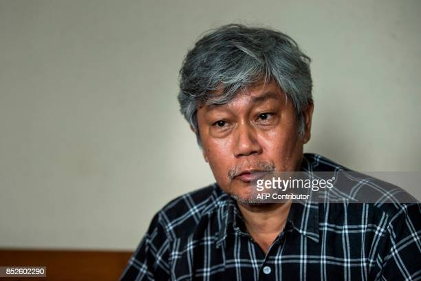 This photo taken on September 22 2017 shows one of Myanmar's most famous cartoonists Win Naing whose pen name is Aw Pi Kyeh speaking during an...