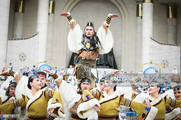 This photo taken on September 23 2015 shows Mongolian dancers performing during a celebration of the 800th birthday of conqueror Kublai Khan in Ulan...