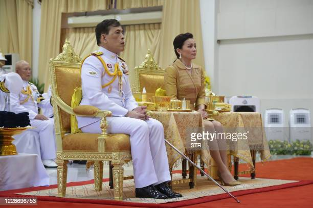 This photo taken on September 24, 2020 shows Thailand's King Maha Vajiralongkorn and Queen Suthida attending an event at Siriraj Hospital in Bangkok.