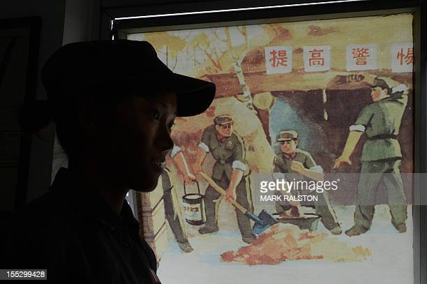 This photo taken on September 25 2012 shows a staff member dressed as a Revolutionary Guard at Fan Jianchuan's Cultural Revolution museum near...