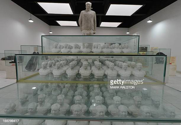 This photo taken on September 25 2012 shows statues of former Chinese leader Mao Zedong at Fan Jianchuan's Cultural Revolution museum near Chengdu in...
