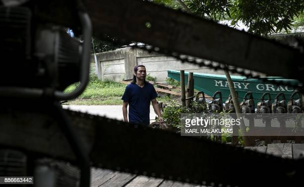 This photo taken on September 25 shows environmental lawyer Robert Chan head of the Palawan NGO Network Inc arriving at the groups headquarters in...