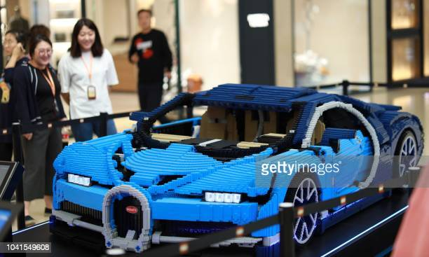 This photo taken on September 26 2018 shows a model of a Bugatti Chiron supercar made from Lego blocks on display at a shopping mall in Shenyang in...