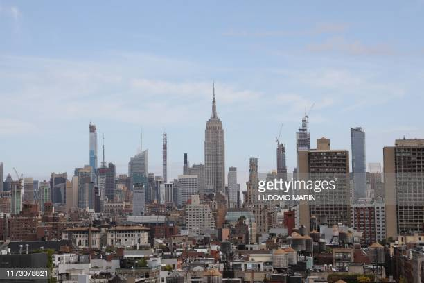 This photo taken on September 26 shows the Empire State Building and other buildings in downtown Manhattan New York