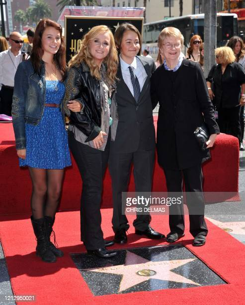 This photo taken on September 27 2011 shows singer Melissa Etheridge posing with her son Beckett daughter Bailey and mother Edna during her Walk of...
