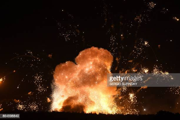 TOPSHOT This photo taken on September 27 2017 near Kalynivka shows explosions at a military munitions depot Ukranian authorities evacuated nearly...