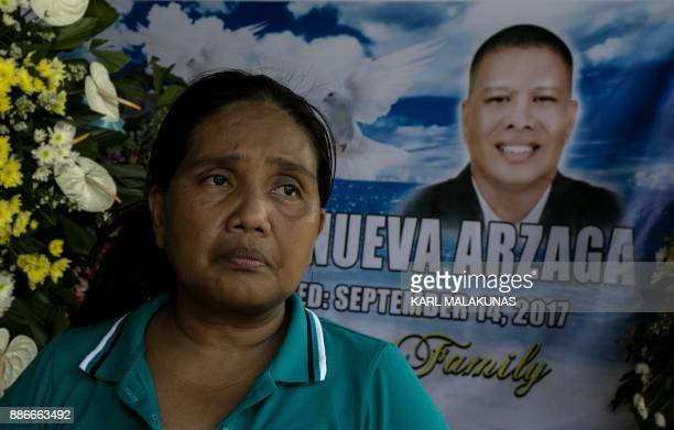 This photo taken on September 27 shows Adelita Arzaga widow of murdered environmental paraenforcer and PNNI member Ruben Arzaga sitting in front of a...