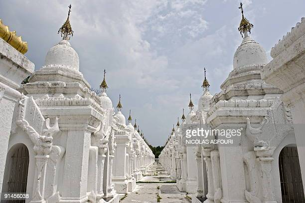 This photo taken on September 28 2009 shows some of the 729 stupas of the Kuthodaw pagoda in Mandalay The pagoda contains the world's largest book...