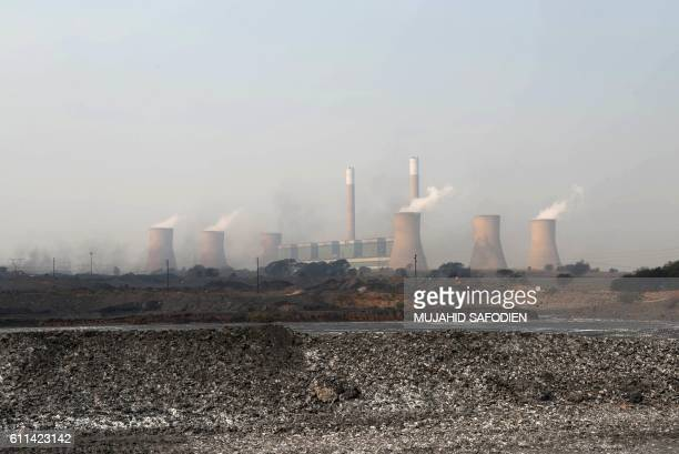 This photo taken on September 28, 2016 on the outskirts of Witbank shows Mooifontein Colliery coal supplier to the Kendal and Duvah coal plant power...