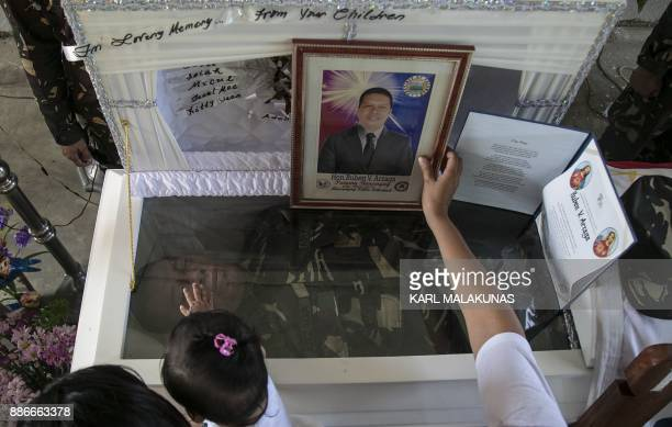 This photo taken on September 28 shows mourners paying their respects to murdered environmental paraenforcer Ruben Arzaga from the Palawan NGO...
