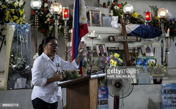 This photo taken on September 28 shows Nieves Rosento mayor of the town of El Nido Palawan island the Philippines speaking at the wake of murdered...
