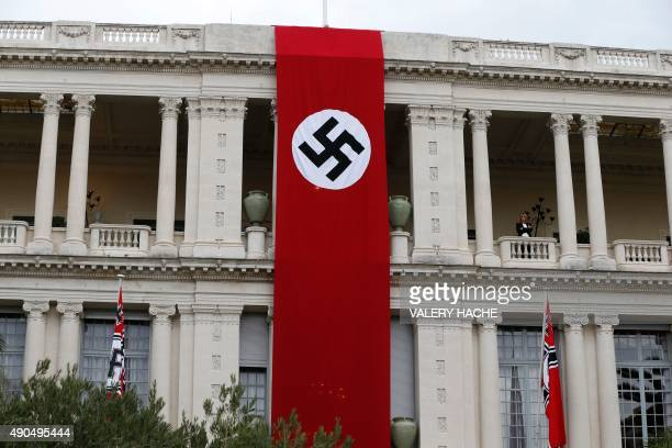 This photo taken on September 29 2015 shows a Nazi flag draped over the side of a building for the filming of Canadian director Christian Duguay's Le...