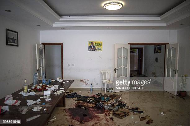 TOPSHOT This photo taken on September 3 2016 in Libreville shows a pool of blood on the floor of the conference room inside of Gabon's opposition...