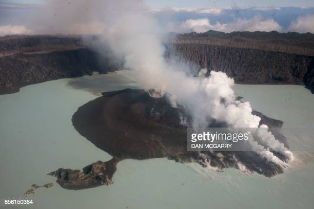 TOPSHOT This photo taken on September 30 2017 shows the Manaro Voui volcano on Vanuatu's Ambae island where the volcano is threatening a major...