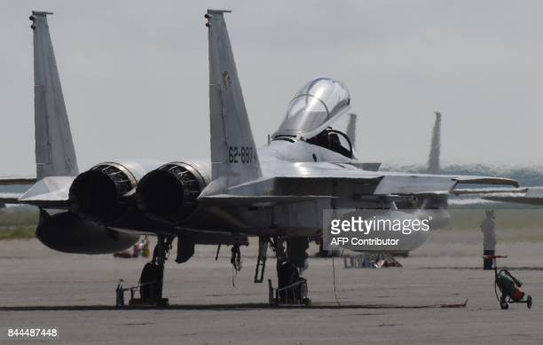This photo taken on September 7 2017 shows F15J Eagle fighter aircraft Japan Air SelfDefense Force 2nd Air Wing 201st Tactical Fighter Squadron at...
