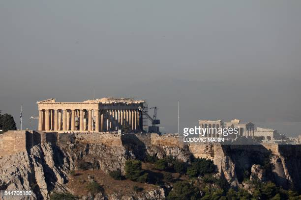 This photo taken on September 7 2017 shows the Acropolis in Athens during sunrise / AFP PHOTO / ludovic MARIN
