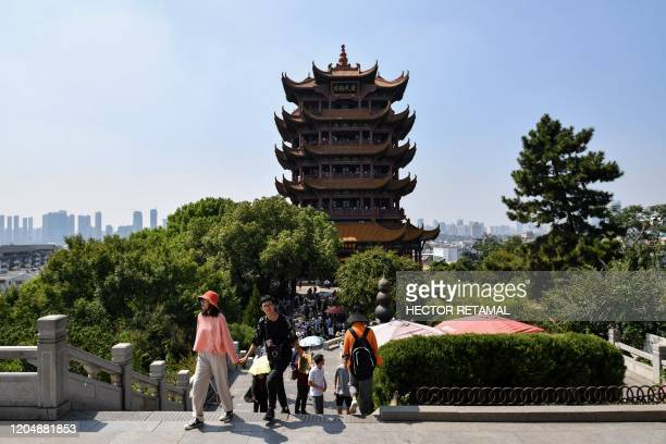 This photo taken on September 7, 2019 shows tourists visiting Yellow Crane Tower in Wuhan in China's Hubei Province.