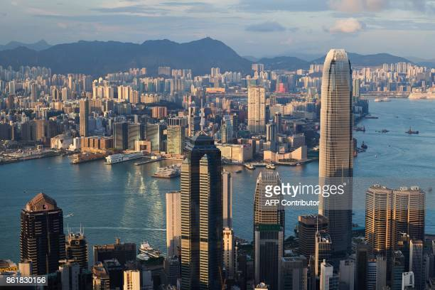 TOPSHOT This photo taken on September 8 2017 shows The Centre skyscraper located in the city's bustling Central district of Hong Kong A landmark...