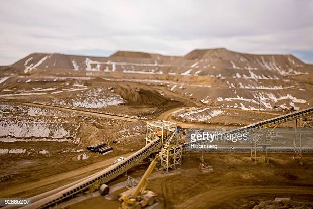 This photo taken with a tiltshift lens shows a conveyor belt and crusher at the AngloGold Ashanti Ltd Cripple Creek Victor gold mine in...