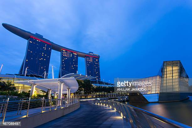 This photo was shot at walkway in front of Marina Bay Sands at twilight time. Marina Bay Sands is an integrated resort fronting Marina Bay in...