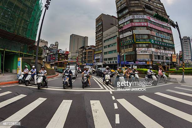 CONTENT] This photo was shot in downtown of Taipei There are a lot of camera shop in this area The motorcycle stuck due to red light traffic