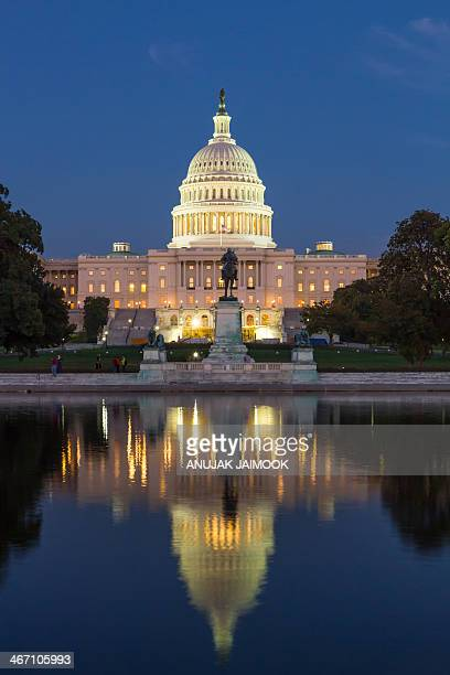 This photo was shot in the evening time. The color of building become light orange due to the sun light. The United States Capitol is the meeting...