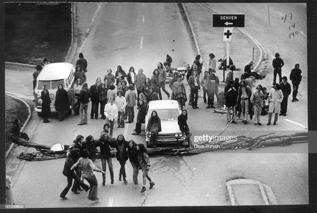 This photo was taken in 1972. Demonstrators dance before barricades in Boulder after traffic was stopped in protest of Richard Nixon's Vietnam War plans. Historical Collection : News Photo