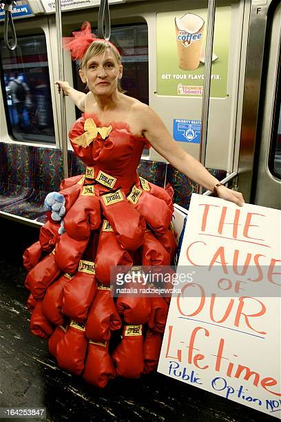 This photo was taken on the MBTA red line train ahead of the 2009 health care debate. The boxing glove dress was to show that it would be the battle...