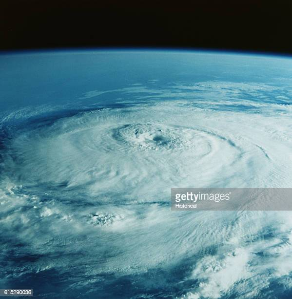 This photograph from the Apollo 7 spacecraft shows the eye of Hurricane Gladys swirling over the southeast United States and Cuba