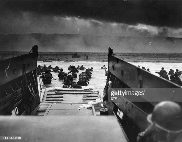 This photograph from the National Archives taken on June 6 shows US Army troops wading ashore at Omaha Beach in northwestern France during the DDay...