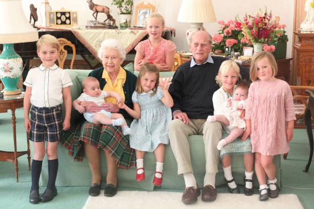 GBR: Queen Elizabeth II And Prince Philip, Duke of Edinburgh With Their Great Grandchildren