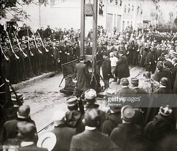 This photograph obtained under great difficulties depict the manner of execution by the guillotine in France As is customary the execution takes...