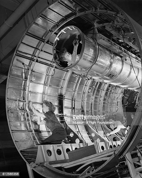 This photograph of women assembling the fuselage of a B29 bomber at the Boeing Plant in Renton Washington in August 1944 was published in WOW by the...
