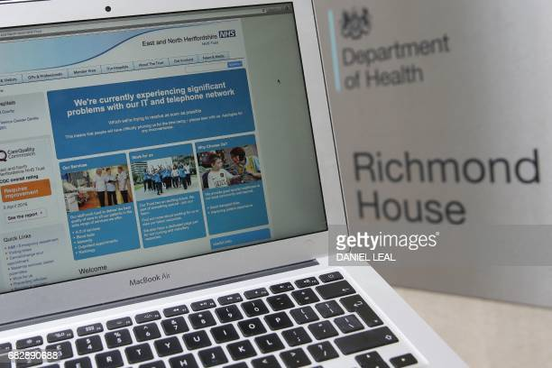 This photograph posed as an illustration on May 12 shows the website of the NHS East and North Hertfordshire notifying users of a problem in its...