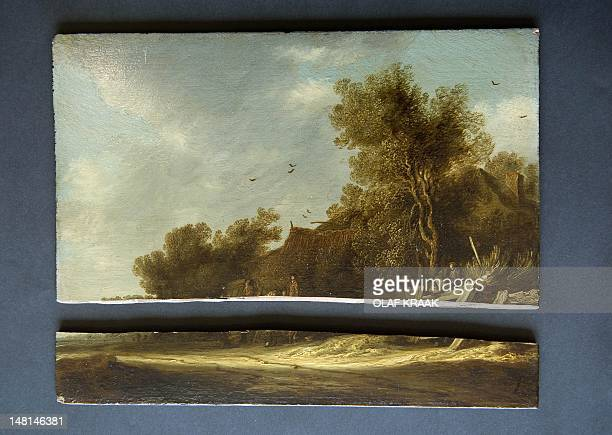 This photograph shows a broken painting by Salomon van Ruijsdael at Christie's saleroom in Amsterdam on July 11, 2012. The police found five of seven...
