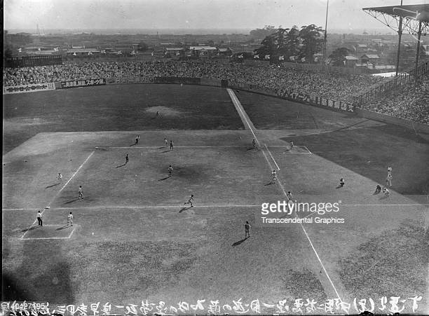 This photograph shows a high school championship Japanese baseball game being played at Koshien Stadium in Osaka, Japan in 1920.