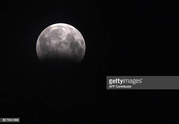 This photograph shows a partial Lunar eclipse as seen from the southern Indian city of Chennai late August 7 2017 The phenomenon occurs when the moon...