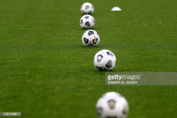 This photograph shows balls on the lawn before the beginning of the friendly football match between France and England, at the Michel dOrnano Stadium...